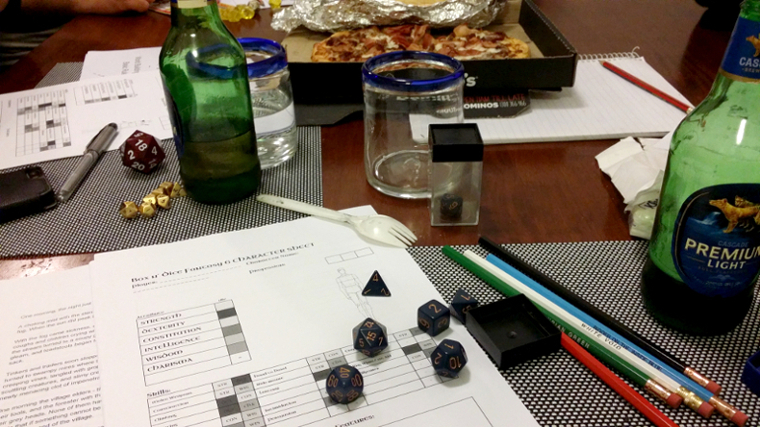 A box o' dice, paper, pencils, beer and pizza: ALL the essentials.